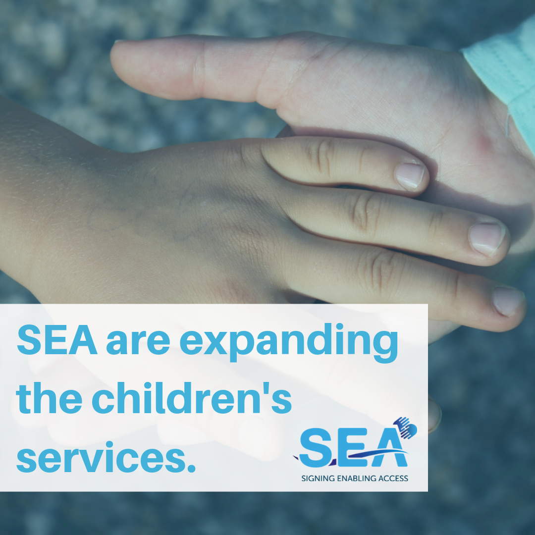 Two children's hands with expansion of services